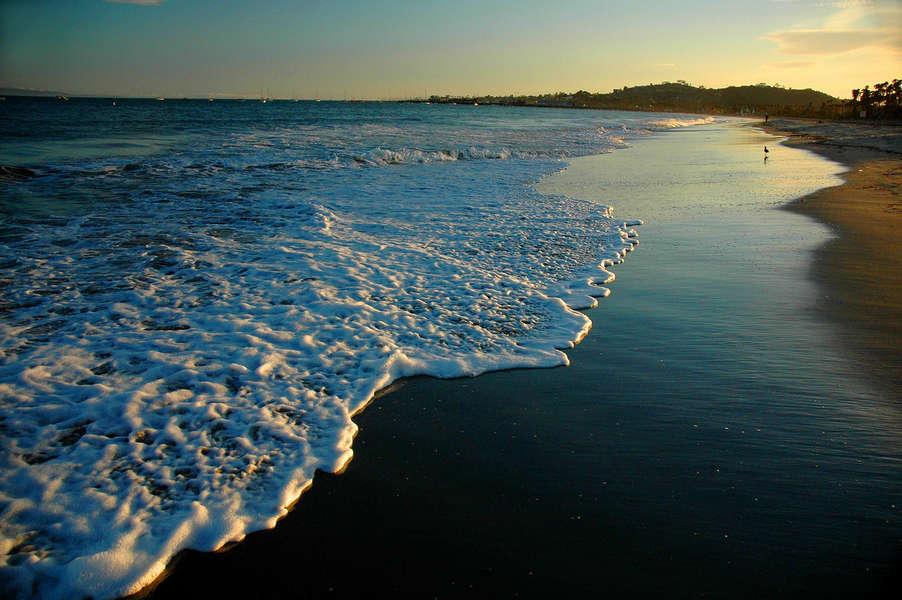 Enjoy a beach walk at sunset
