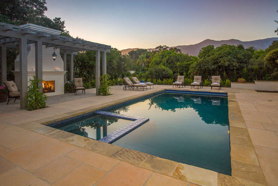 Enjoy the sunset around the pool and outdoor fireplace