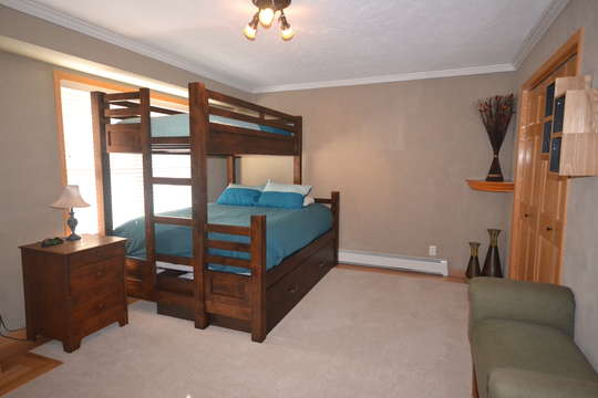 Bedroom 2 with Queen Captains bunk, private bathroom, and open views of National Forest