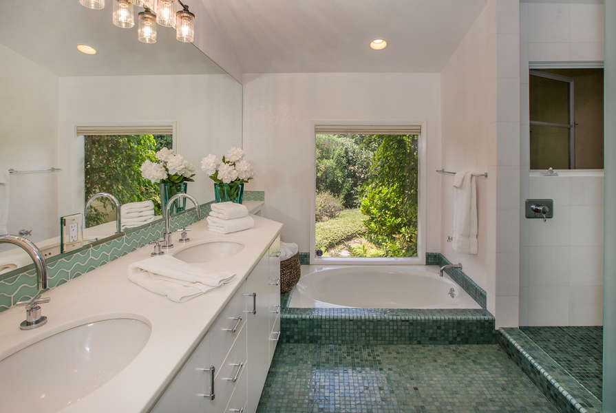Master Bathroom with walk-in shower and sunken tub