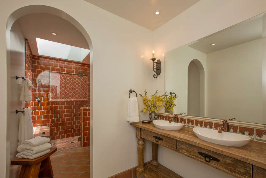 Hall Bathroom with beautiful tile throughout