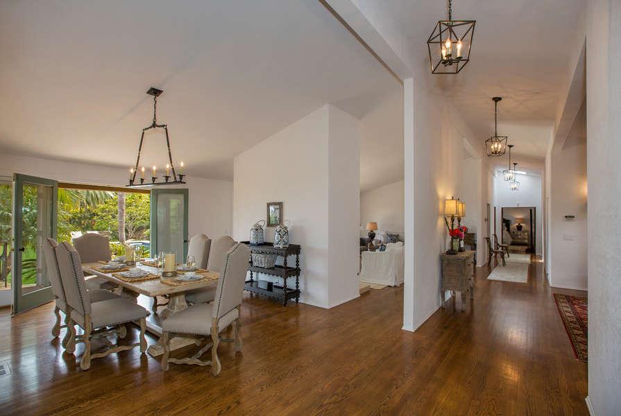 Beautiful wood flooring and vaulted ceilings