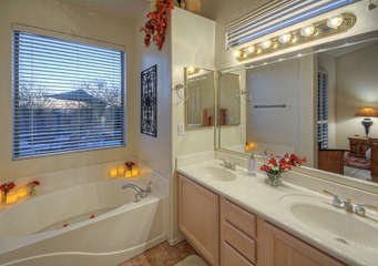 Garden tub and separate glass shower are desirable features of master bath