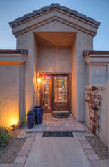 Custom designed front entrance invites you and your guests to enter