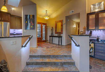 Gorgeous foyer with steps to sunken great room