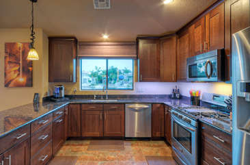 Open and bright kitchen with views of lake from window
