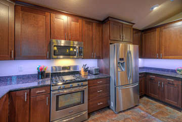 Large kitchen with vast counter space and under-cabinet lighting