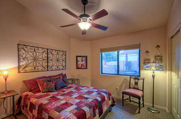 Second bedroom has king bed, large closet and view of patio