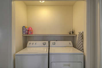 Washer and dryer in hallway alcove