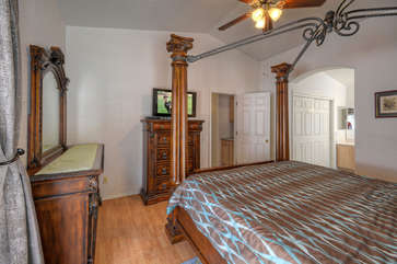 Master bedroom has TV and ample drawer space for wardrobe and accessories