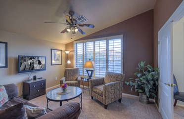 Sitting area off master bedroom has golf course views and a sleeper sofa that sleeps two additional guests
