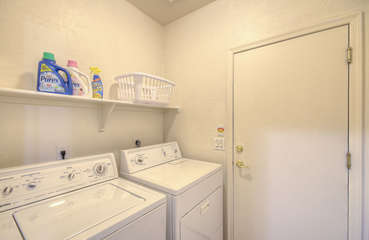 Separate laundry room with family-size washer and dryer to keep wardrobe clean and ready to go