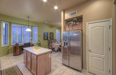 Stainless steel appliances, granite countertops and generous work space keep the cook happy