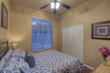 Pretty fourth bedroom on first floor has queen bed