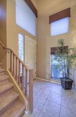 Custom front entrance foyer hints at home's elegant yet homey interior