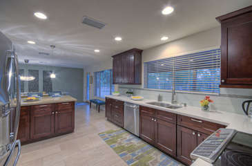 Impressive features of newly remodeled kitchen include granite counters and stainless steel appliances