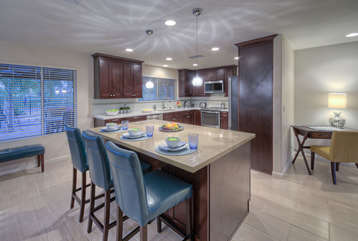 Kitchen is bright and cheerful place to prepare mouthwatering feasts. Corner desk provides space to complete work-related tasks if your job travels with you.