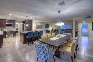 Open floor plan includes elegant bar seating plus comfortable dining area for casual and formal meals