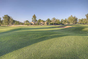 Home's patio has exciting golf course view of Starfire Golf Club, a popular daily fee public course with 27 holes