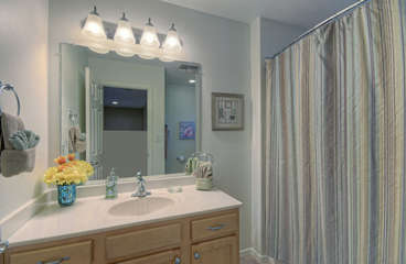 Upstairs bathroom features tub/shower combination