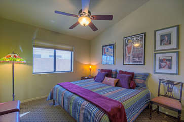 Third bedroom features a new king bed and TV