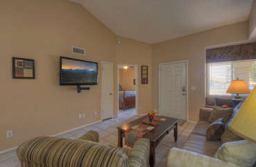 Great room offers a comfortable gathering area for watching large TV