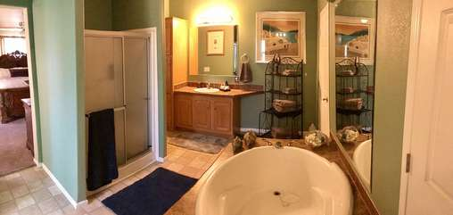 Features of master bath include garden tub, stand alone walk-in shower, separate commode room and dual vanities with sinks