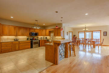 Wildlife Manor`s Stainless Steel Gas Stove, Microwave, and Large Sink in Beautiful Large Open Kitchen open to Great Room.