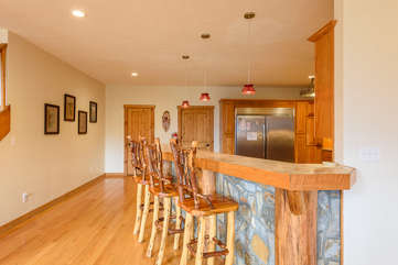 Wildlife Manor classic mountain cedar wood and stone-work provides additional dining at the kitchen bar