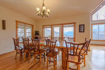 Wildlife Manor Custom Made Dining Table that comfortably seats 12 in custom-made cedar chairs
