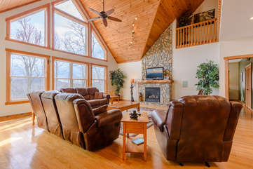 Wildlife Manor Living Room with Gas Stove Fireplace, Flat Screen TV with Surround Sound, Views and Luxury Leather Furniture.