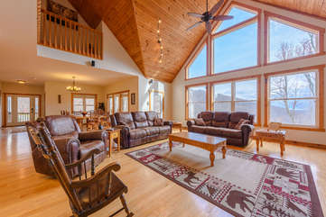 Wildlife Manor Living Room - Large flat screen TV with surround sound; leather sectional sofa with Queen pull-out, and reclining chair
