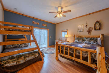Wildlife Manor Bedroom sleeps 5 with queen log bed & separate twin over full bunk. This Room is on the same level as Pool Table, Ping Pong Table & Theatre