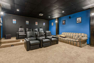 Wildlife Manor Cinema with Theatre lighting, Luxury Leather Seating, 115 inch projection screen, Surround Sound and plenty of floor lounging space