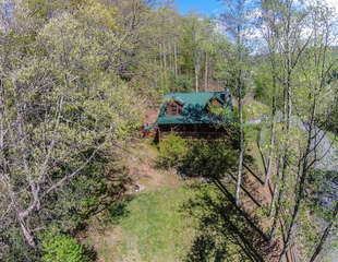 3 Bears Den Front Side of Home With Large Yard and Outdoor Fire Pit