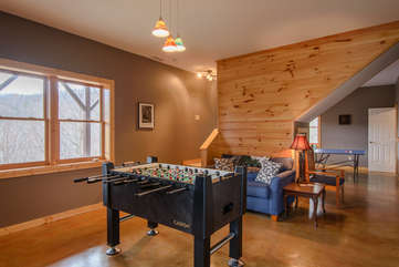 Downstairs Game Room With Foosball and Ping Pong Tables