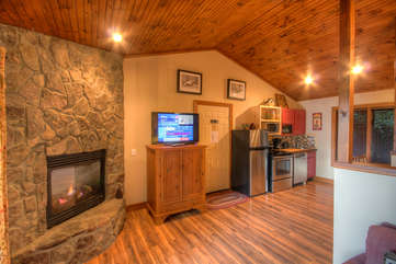 Living Area with Stone Fireplace and Flatscreen TV