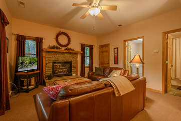 Boulder Falls Retreat Second Den with Flat Screen TV and stone gas fireplace