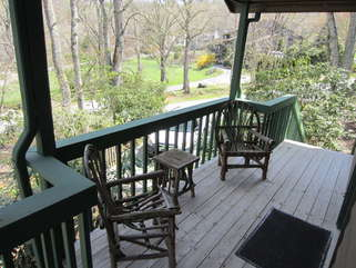Cherokee Cottage Sitting area on covered entry porch.