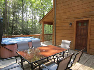 Elk Laurel Hot Tub on Large Spacious Deck with Covered Porch Right next to Hot Tub. Large Outdoor Table for Deck shares open Deck