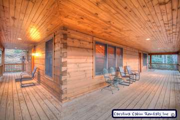 Elk Laurel Large Wrap Around Porch connected to Hot Tub Deck and Outdoor Dining Table and Gas Grill