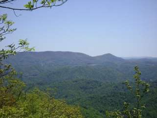 Come Enjoy the outstanding views at the top of the hiking trails on this private 14 acre property