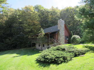 Laurel Chase Cabin with paved road and flat paved driveway access. Just 2 steps up onto back deck and into house.