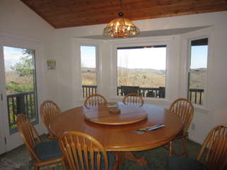 Mountain Sunrise Dining Room View - This view just draws your eye from throughout the great room