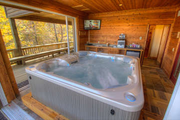 North View Lodge one-of-a-kind indoor/outdoor Hot Tub room. Note: TV removed due to water damage.
