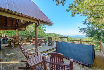 Whispering Pines back deck with Hot Tub, comfortable seating, beautiful view