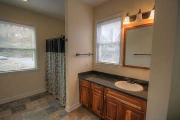 Whispering Hills Main Floor Master Suite Full Bath with Slate Floors, Granite Counters and Tub Shower