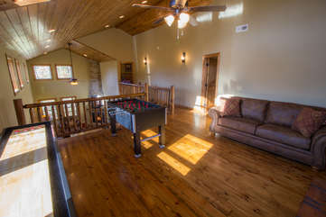 Skyland Cabin Open Loft with Game Tables and comfy Leather Sofa