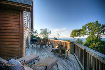 Pinecone Manor Long Deck with Grill and Outdoor Dining, Lounge and Adirondack Chairs