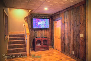 Pinecone Manor Authentic Barnwood Accent Walls in Game Room TV area